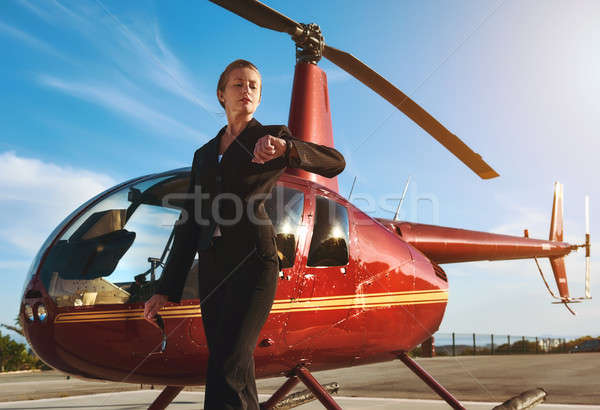 Business woman near the helicopter Stock photo © amok