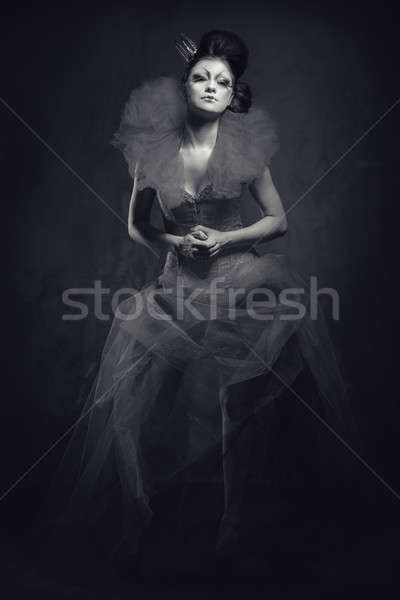 Queen. Woman with creative make-up in fluffy dress posing indoors Stock photo © amok
