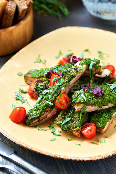 Pork ribs with a spicy garlic and fresh herbs sauce  Stock photo © amok