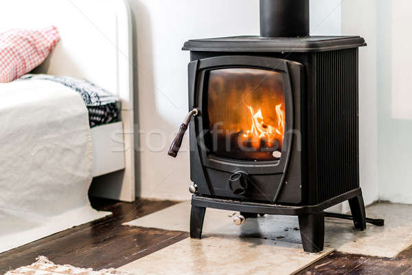 Wood burning stove in bedroom Stock photo © amok