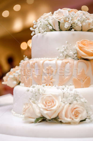 Beautiful wedding cake decorated with orange roses Stock photo © amok