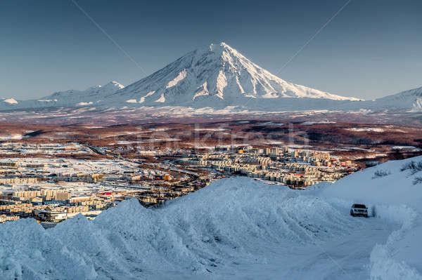 Petropavlovsk-Kamchatsky cityscape and Koryaksky volcano at sunrise Stock photo © amok
