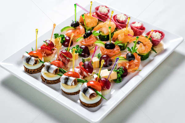 Stock photo: Plate with various seafood and meat canapes