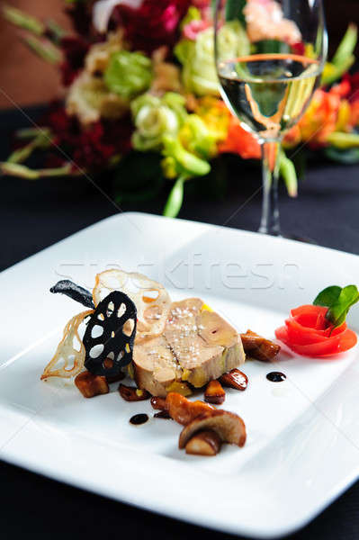 Juicy goose liver on a plate and glass of white wine  Stock photo © amok