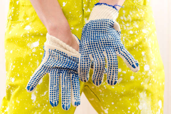 Female construction worker in coverall and protective gloves Stock photo © amok