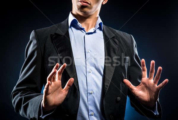 Man elegante zwarte jas Blauw shirt Stockfoto © amok