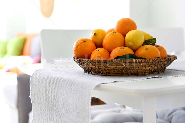 Fresh lemons and mandarin orange fruits on a wicked plate Stock photo © amok