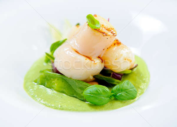 Delicious dish with fish fillet and green curry on a plate Stock photo © amok