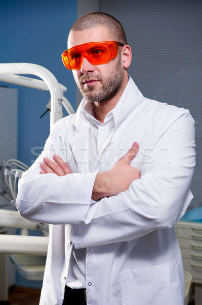 Confident successful doctor at dental clinic Stock photo © amok
