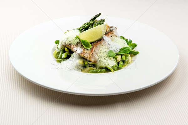 Sea bass fillet with asparagus infused with sauce foam Stock photo © amok