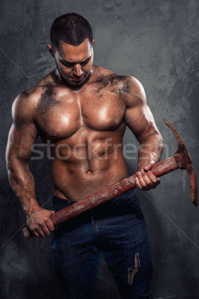 Muscular man holding pickaxe Stock photo © amok