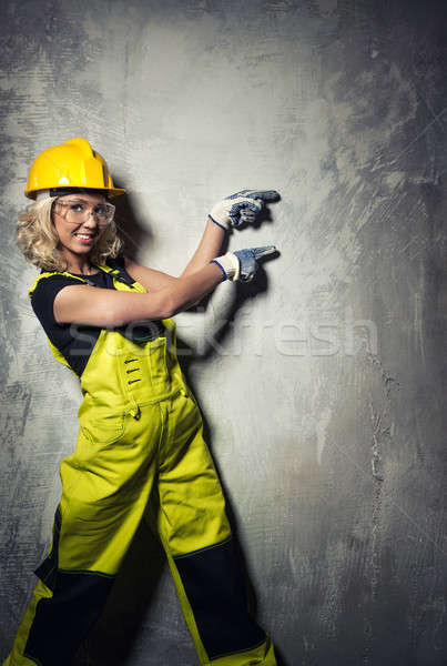 Attractive builder woman showing something with the hands Stock photo © amok