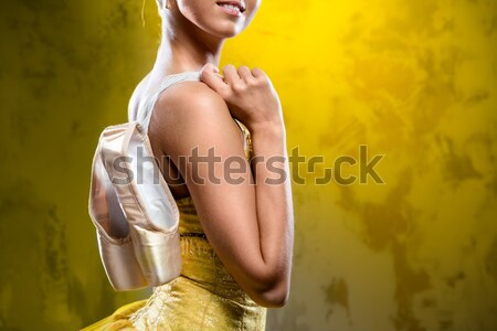 Ballerina with pointe shoes against obsolete wall background Stock photo © amok