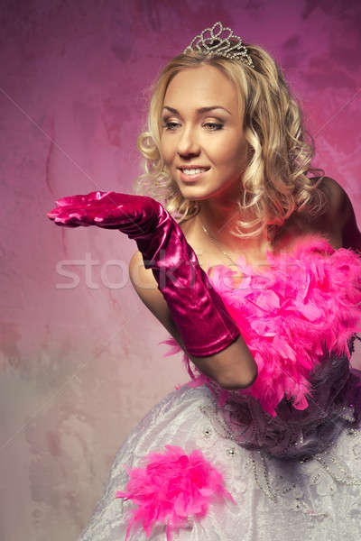Lovely woman in bridal dress showing something with the hand Stock photo © amok