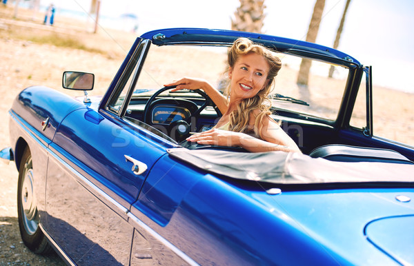 Stock photo: Beautiful woman sitting in retro cabriolet car