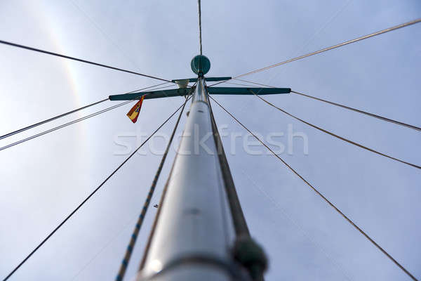Mast of the sailing yacht against cloudy sky Stock photo © amok