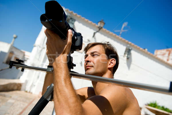 Handsome man with camcorder outdoors Stock photo © amok