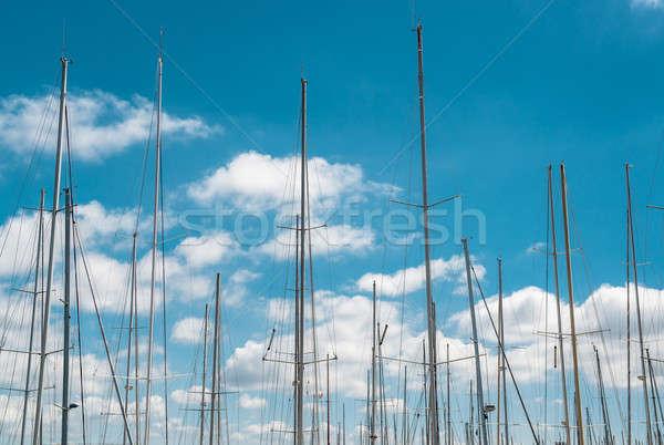 Ship masts over blue sky background Stock photo © amok