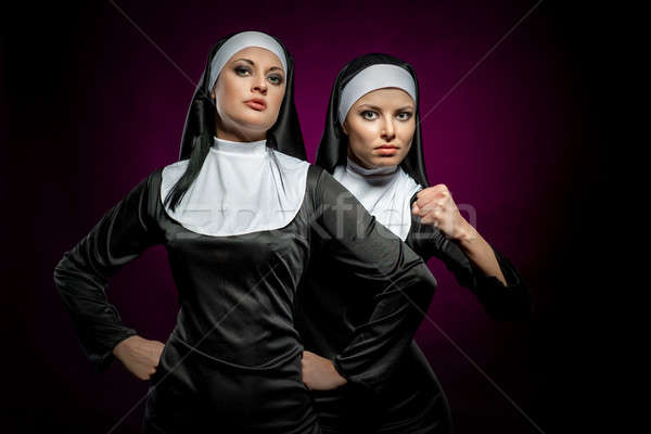 Two attractive young nuns indoors Stock photo © amok