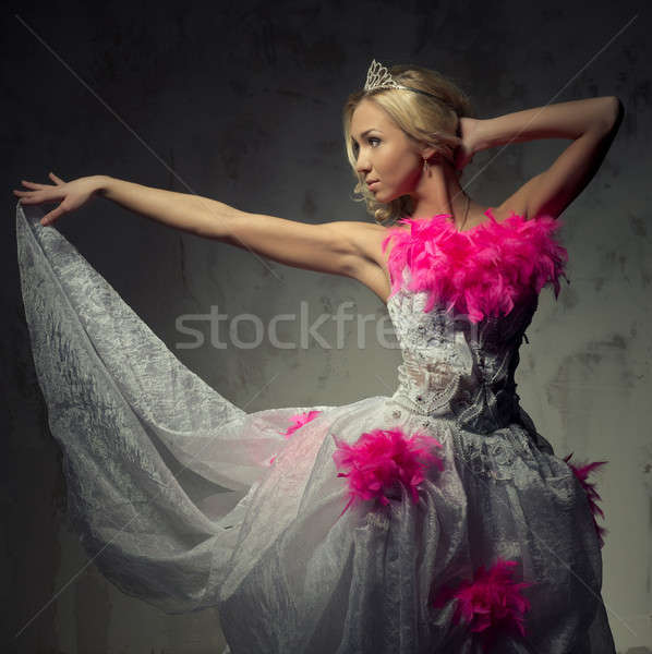 Lovely woman wearing white dress decorated with pink feather boa Stock photo © amok
