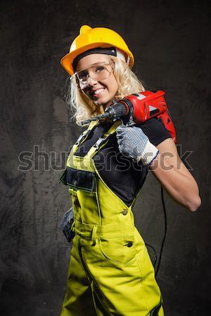 Vonzó építész nő fúró kezek fal Stock fotó © amok