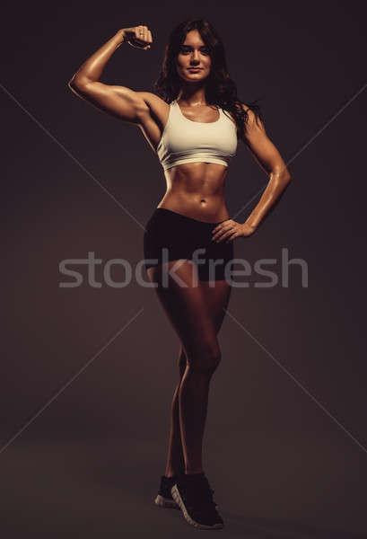 Hermosa jóvenes mujer bíceps Foto stock © amok