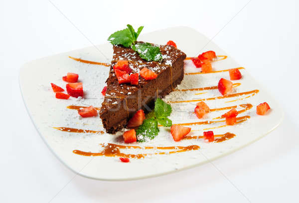 Slice of luscious chocolate pie with caramel and fresh strawberr Stock photo © amok