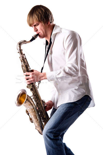 Young man with saxophone over white background  Stock photo © amok