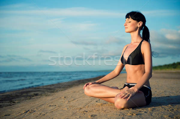 Woman doing yoga exercise outdoors Stock photo © amok