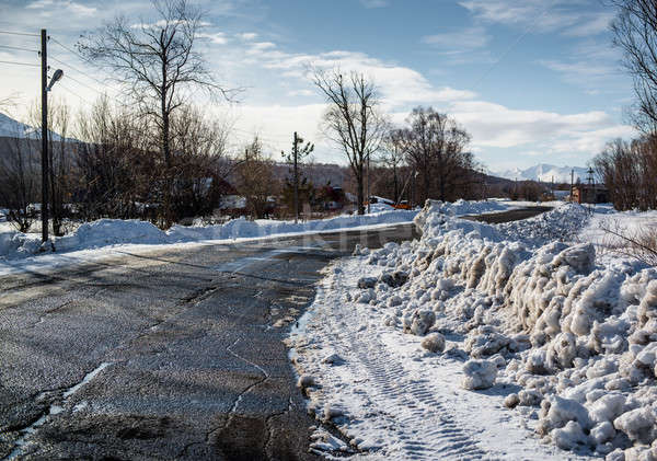 Snowdrifts and rural road. Petropavlovsk-Kamchatsky in march Stock photo © amok