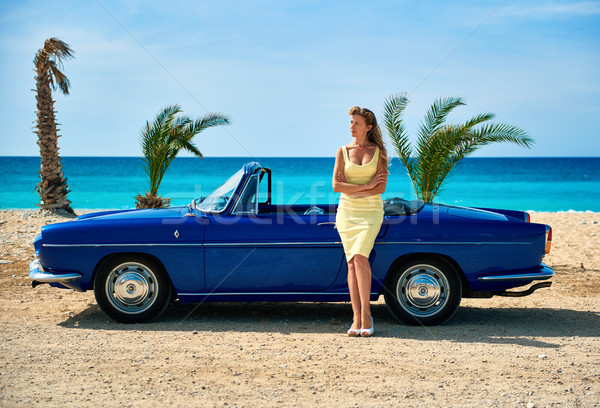 Beautiful woman standing near retro cabriolet car  Stock photo © amok