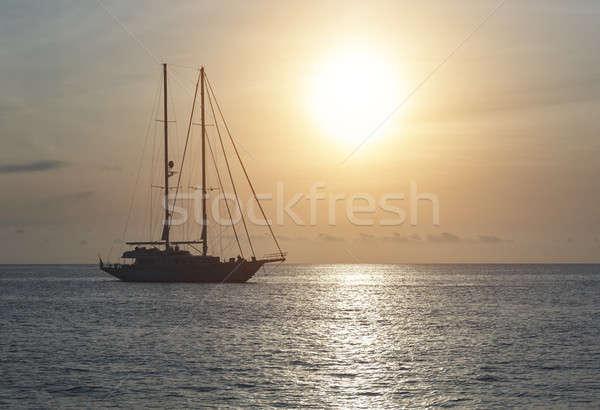 Yacht at Cala Saona in Formentera during sunset. Balearic Islands Stock photo © amok