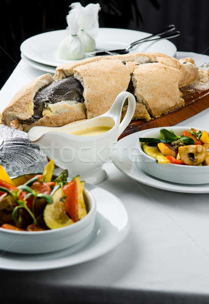 Baked whole sea bass fish in a salt crust  Stock photo © amok