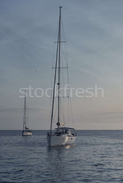 Yacht at Cala Saona in Formentera at sunset. Balearic Islands Stock photo © amok