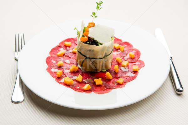 Venison carpaccio with sea buckthorn marmalade and sprout salad Stock photo © amok