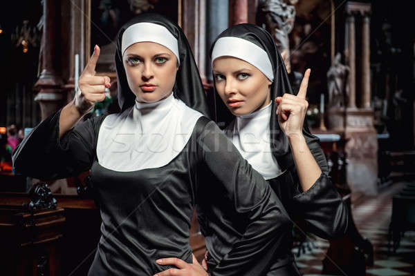 Attractive young nuns posing in the church Stock photo © amok