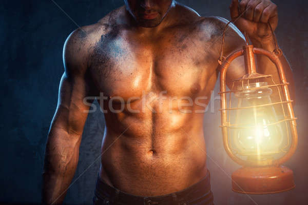Muscular man holding oil lamp Stock photo © amok