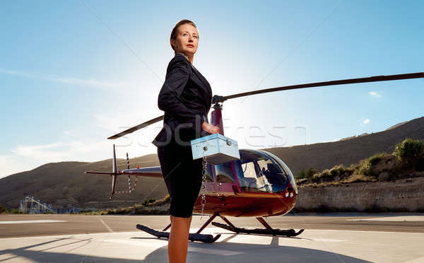 Elegant business woman near the helicopter Stock photo © amok