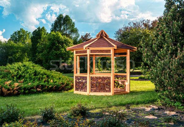 Outdoor wooden gazebo over summer landscape background Stock photo © amok