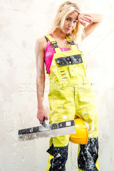 Tired female construction worker with putty knife working indoors Stock photo © amok