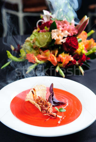 Tomato soup garnished with ham and herbs with alder smoke Stock photo © amok