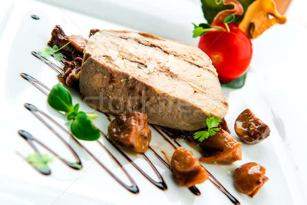 Sliced foie gras with sauce and chanterelle mushrooms  Stock photo © amok