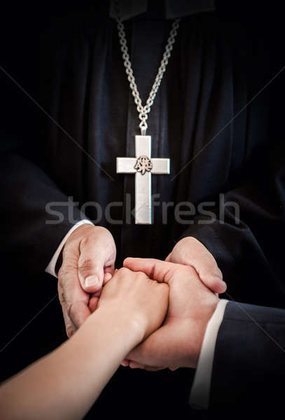 Priest holding bride's and groom's hands during wedding ceremony Stock photo © amok