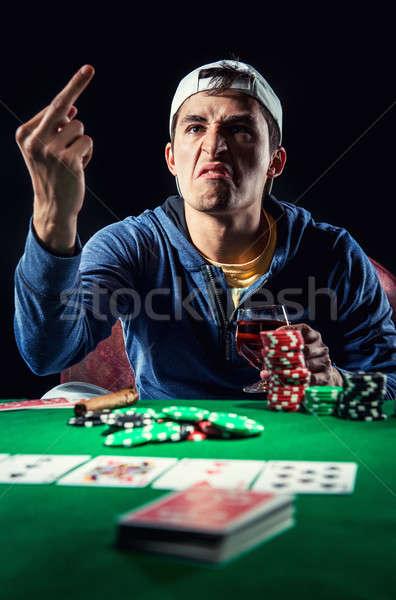 Agresif genç kumarbaz adam kumarhane Stok fotoğraf © amok