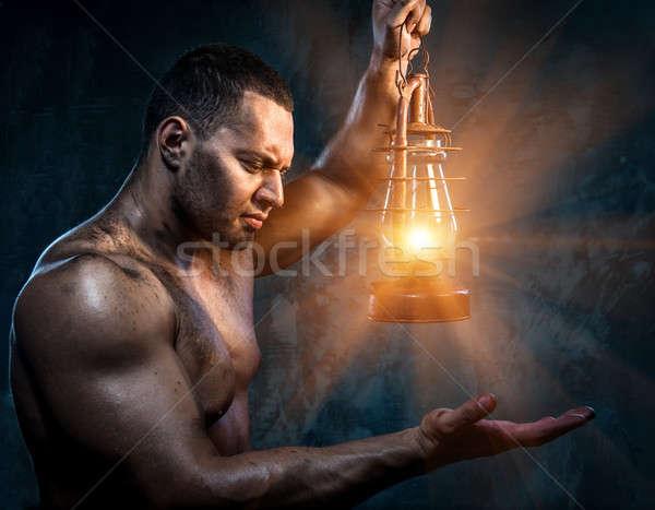 ストックフォト: 筋肉の · 男 · 石油ランプ · 手 · 光