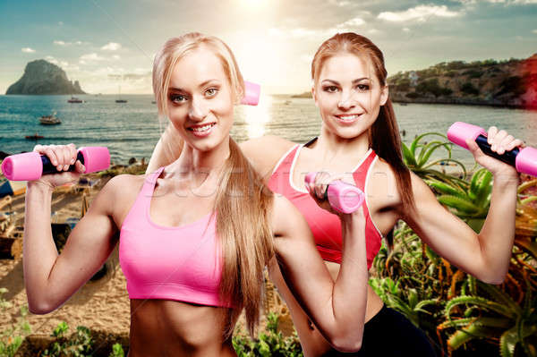 Stock photo: Girls doing fitness exercise with dumbbells