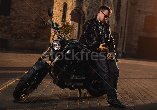 Stock photo: Man with a cafe-racer motorcycle outdoors