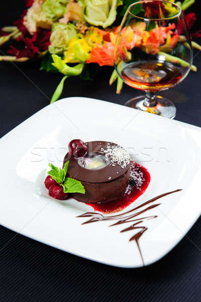 Luscious chocolate dessert with fresh berries on a plate Stock photo © amok