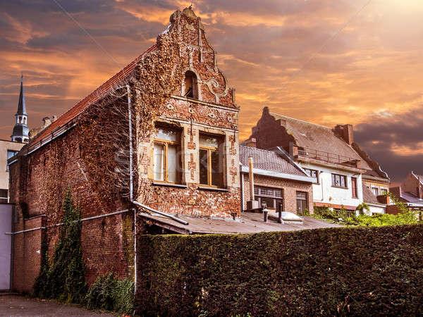 Oude gebouwen stad België zonsondergang straat Stockfoto © amok