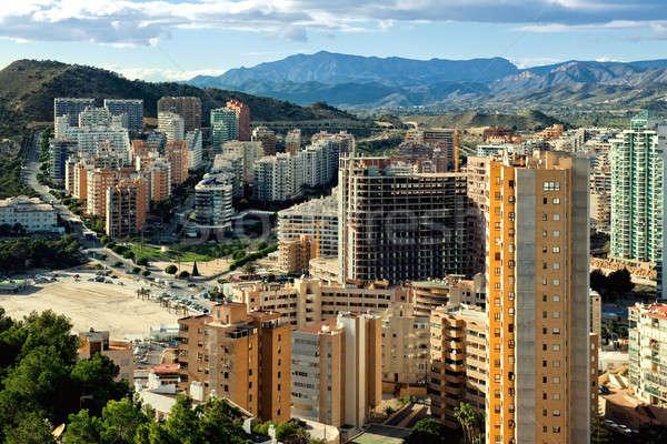 Modern felhőkarcolók tengerparti város égbolt iroda Stock fotó © amok